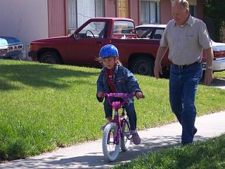Click image for larger version  Name:Hannah, almost 7, learning to ride a bike--2, March 2008.jpg Views:133 Size:88.0 KB ID:6587