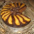A twist on the Upside-Down Pear Gingerbread Cake of note in the novel, Eat Cake, by Jeanne Ray. The best cake I've had in decades. It's cooked in a...